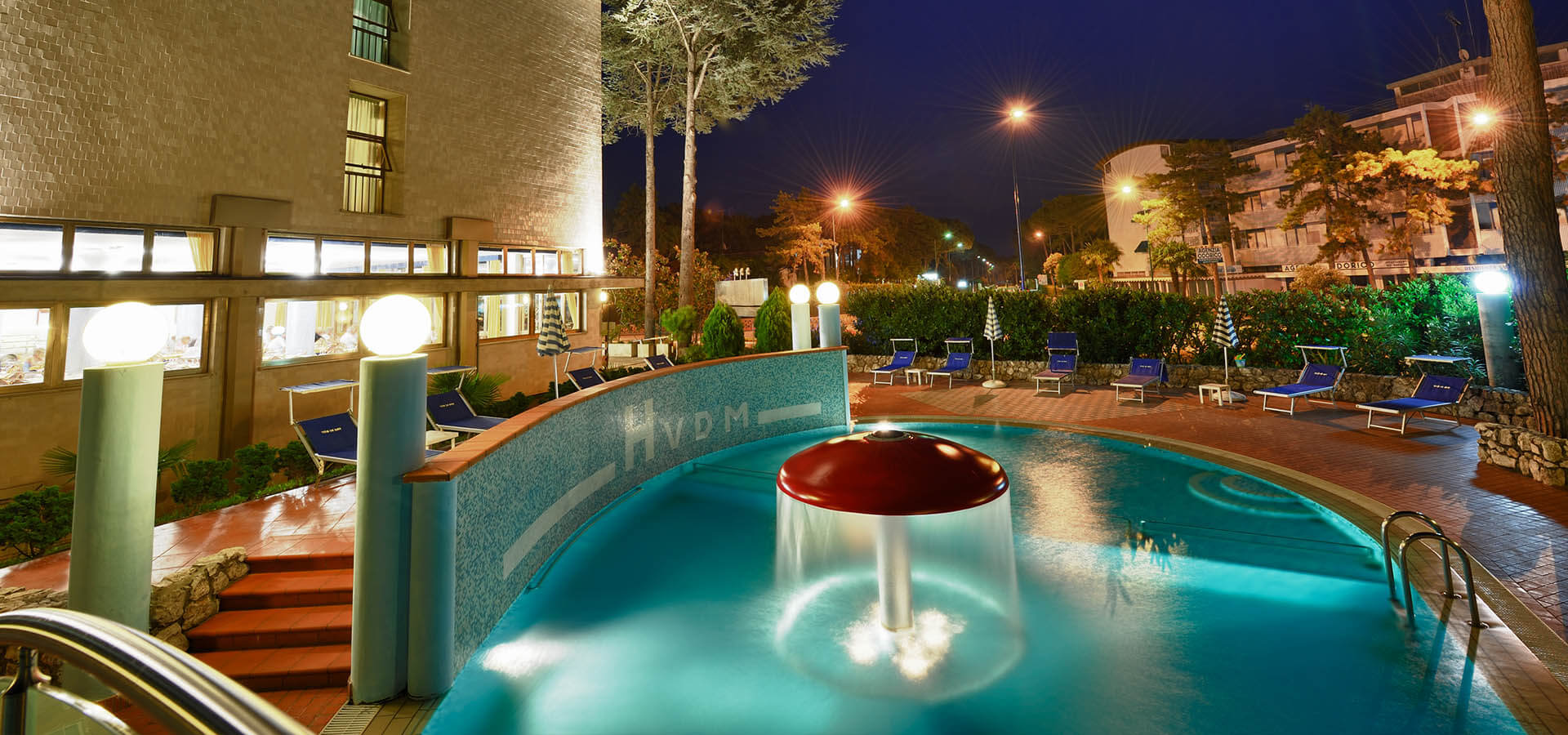 hotel with swimming pool by night
